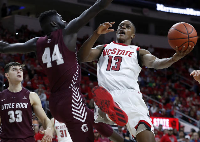 North Carolina State's C.J. Bryce (13) is fouled by Arkansas-Little Rock's Ruot Monyyong (44) as he shoots during the second half of an NCAA college basketball game at PNC Arena in Raleigh, N.C., Saturday, Nov. 23, 2019. (Ethan Hyman/The News & Observer via AP)