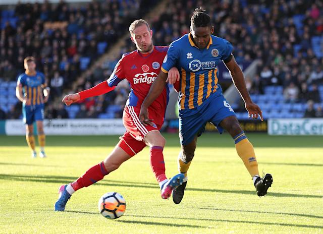 Soccer Football - FA Cup First Round - Shrewsbury Town vs Aldershot Town - New Meadow, Shrewsbury, Britain - November 4, 2017 Aldershot Town's Scott Rendell in action with Shrewsbury Town's Omar Beckles Action Images/John Clifton