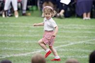 <p>Princess Eugenie at age three was already showing off some personal style in this red and white look, complete with striped bloomers. The little Princess was spotted running around at the Upton House School sports day. </p>