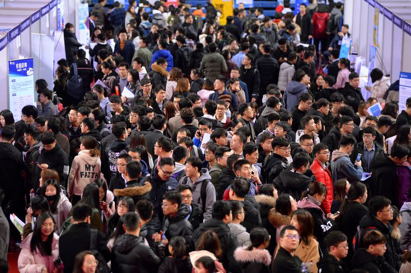 FILE PHOTO: Students are seen at a job fair for graduates at a university in Shenyang, Liaoning