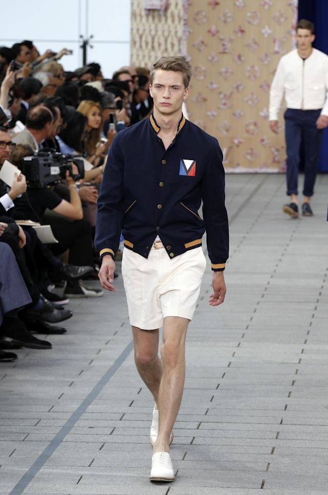 <p>Model wears a nautical-inspired outfit featuring a fitted bomber jacket and white shorts, looking ready to set sail. (Photo: Getty Images) </p>