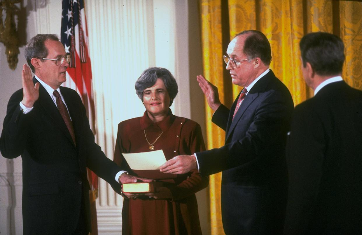 Supreme Court Justice Anthony Kennedy is sworn in in 1988 by then Chief Justice Rehnquist, as wife, Mary, and President Ronald Reagan, right, looks on. (Photo: Dirck Halstead/The LIFE Images Collection/Getty Images)