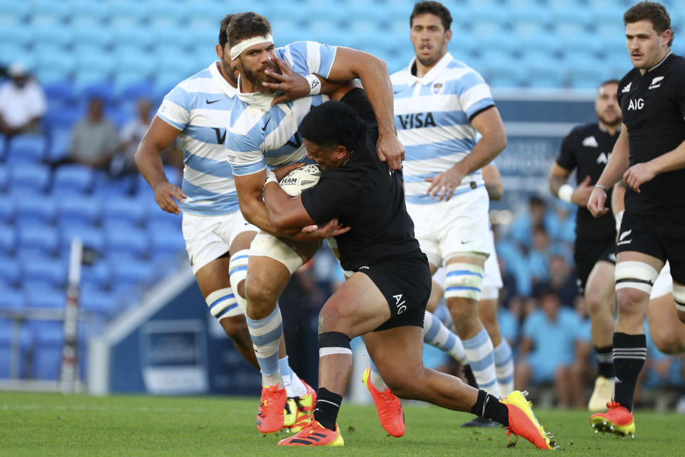Argentina's Marcos Kremer, left, tackles New Zealand's Asafo Aumua during their Rugby Championship match on Sunday, Sept. 12, 2021, on the Gold Coast, Australia. (AP Photo/Tertius Pickard)
