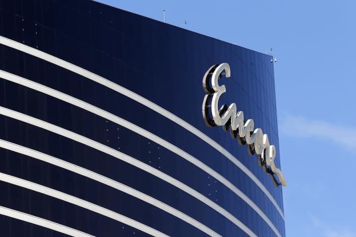 FILE - In this May 22, 2019 file photo, Encore Boston Harbor casino logo looms above the surrounding neighborhood in Everett, Mass. The casino is scheduled to open on Sunday, June 23. (AP Photo/Michael Dwyer, File)