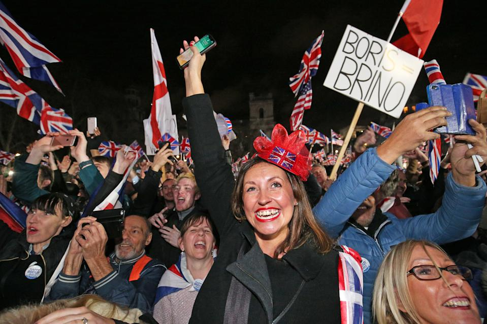 Pro-Brexit supporters celebrate in Parliament Square, London, after the UK left the European Union on Friday, ending 47 years of close and sometimes uncomfortable ties to Brussels.