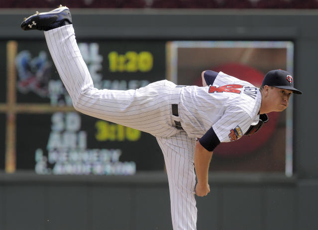2Minnesota Twins' Kyle Gibson pitches against the Detroit Tigers during the first inning of a baseball game Sunday, Aug. 24, 2014,in Minneapolis. (AP Photo/Tom Olmscheid)