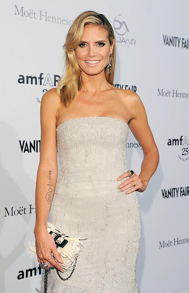 Model and TV host Heidi Klum has been showing off musician husband Seal's name written in elaborate script on her right arm since 2008. Now that the famous couple just announced their divorce, only time will tell what the 38-year-old mom of four will do about the unwanted ink.