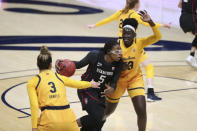 Stanford's Francesca Belibi (5) drives against California's Fatou Samb (33) during the first half of an NCAA college basketball game Sunday, Dec. 13, 2020, in Berkeley, Calif. (AP Photo/Jed Jacobsohn)
