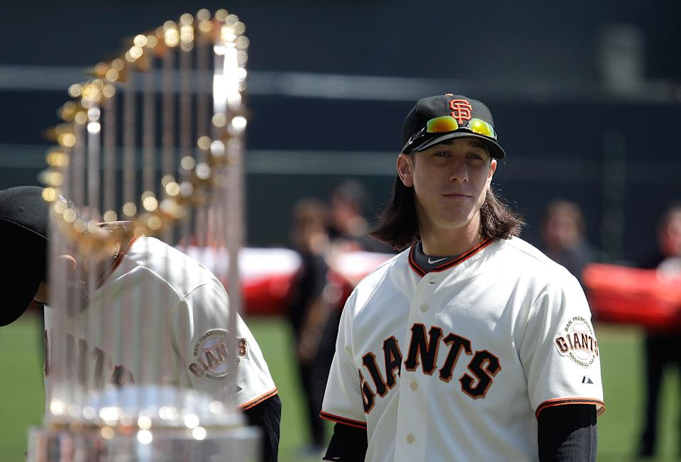 SAN FRANCISCO, CA - APRIL 08:  Tim Lincecum #55 of the San Francisco looks on as he stands next to the 2010 World Series trophy before the start of the Giants' opening day game against the St. Louis Cardinals at AT&T Park on April 8, 2011 in San Francisco, California.  (Photo by Marcio Jose Sanchez-Pool/Getty Images)