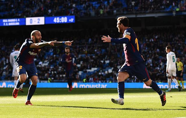 Lionel Messi (right) and Aleix Vidal celebrate Vidal's goal. (Getty)