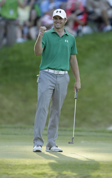 Jordan Spieth reacts after winning the John Deere Classic golf tournament, Sunday, July 14, 2013, at TPC Deere Run in Silvis, Ill. Spieth defeated Zach Johnson and David Hearn in a 5-hole sudden death playoff. (AP Photo/Charlie Neibergall)