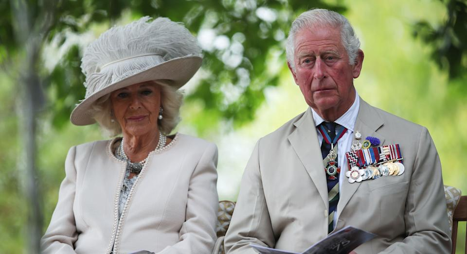 ALREWAS, ENGLAND - AUGUST 15:  Prince Charles, Prince of Wales and Camilla, Duchess of Cornwall attend the VJ Day National Remembrance event, held at the National Memorial Arboretum in Staffordshire, on August 15, 2020 in Alrewas, England. (Photo by Molly Darlington - WPA Pool/Getty Images)