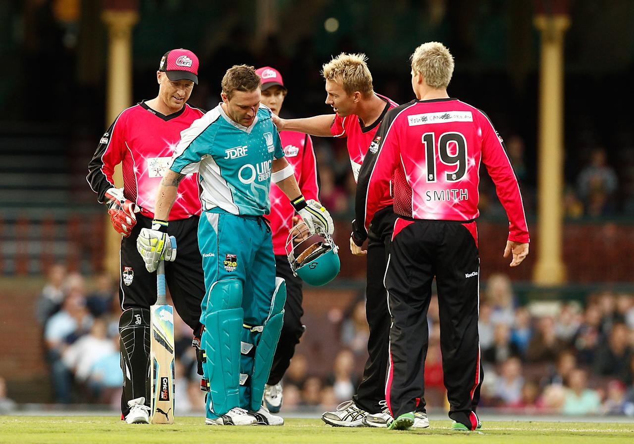 SYDNEY, AUSTRALIA - DECEMBER 16:  Brendon Mccullum of the Heat is consoled by Brett Lee of the Sixers after being struck by a ball to the head during the T20 Big Bash League match between the Sydney Sixers and the Brisbane Heat at Sydney Cricket Ground on December 16, 2011 in Sydney, Australia.  (Photo by Mark Metcalfe/Getty Images)