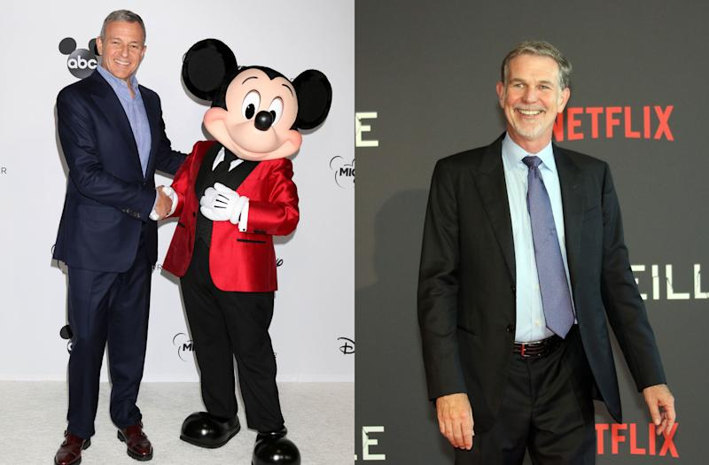 Disney CEO Bob Iger (L) with Mickey Mouse; Netflix CEO Reed Hastings (Credits: David Edwards/MediaPunch/IPX/AP; Claude Paris/AP)