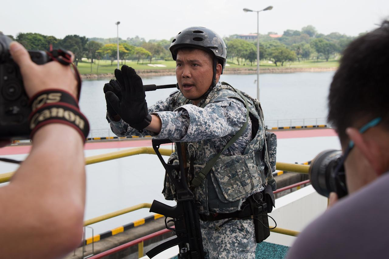 <p>An ASSeT member demonstrating the use of an ASP baton, one of the non-lethal weapons carried by members of the unit. (PHOTO: Yahoo News Singapore / Dhany Osman </p>