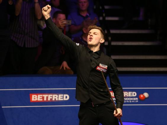 Cahill celebrates his victory over O'Sullivan at the World Snooker Championship (PA)