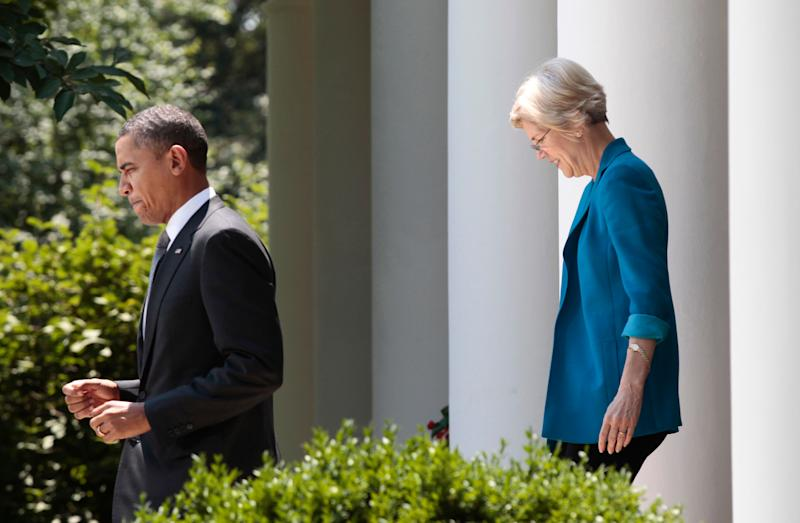 President Barack Obama, followed by Elizabeth Warren, head the Consumer Financial Protection Bureau, walks to the Rose Garden of the White House in Washington, Monday, July 18, 2011, where he announced the nomination of former Ohio Attorney General Richard Cordray to serve as the first director of the Consumer Financial Protection Bureau (CFPB). (AP Photo/Pablo Martinez Monsivais)
