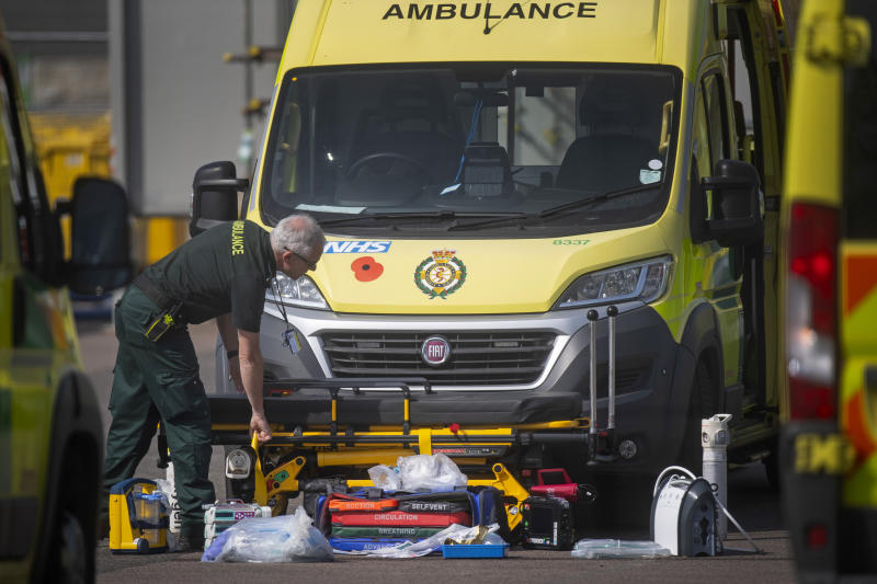 An NHS worker lays out breathing apparatus and equipment outside an ambulance outside the NHS Nightingale Hospital at the Excel Centre in London as the UK continues in lockdown to help curb the spread of the coronavirus.
