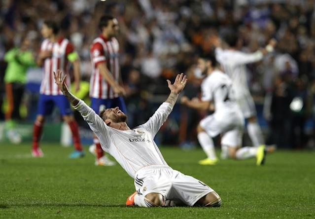 Real's Sergio Ramos, gestures, on hearing the final whistle, at the end of the Champions League final soccer match between Atletico Madrid and Real Madrid, at the Luz stadium, in Lisbon, Portugal, Saturday, May 24, 2014. (AP Photo/Francisco Seco)