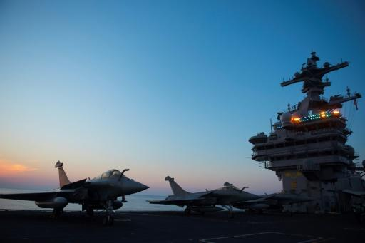 A French Navy Rafale jet is seen early in the morning on the deck of the USS George H.W. Bush aircraft carrier where French crews are honing their skills, in the Atlantic Ocean