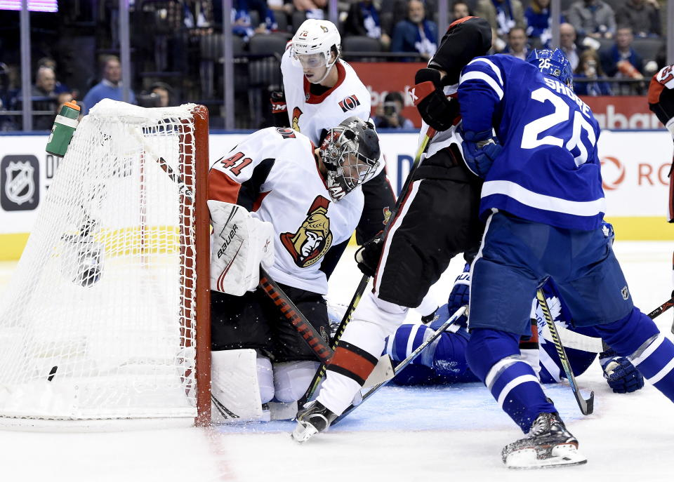 Ottawa Senators goaltender Craig Anderson (41) gets scored on as Toronto Maple Leafs centre Nicholas Shore (26) looks on during the second period of an NHL hockey game, Wednesday, Oct. 2, 2019 in Toronto. (Nathan Denette/The Canadian Press via AP)
