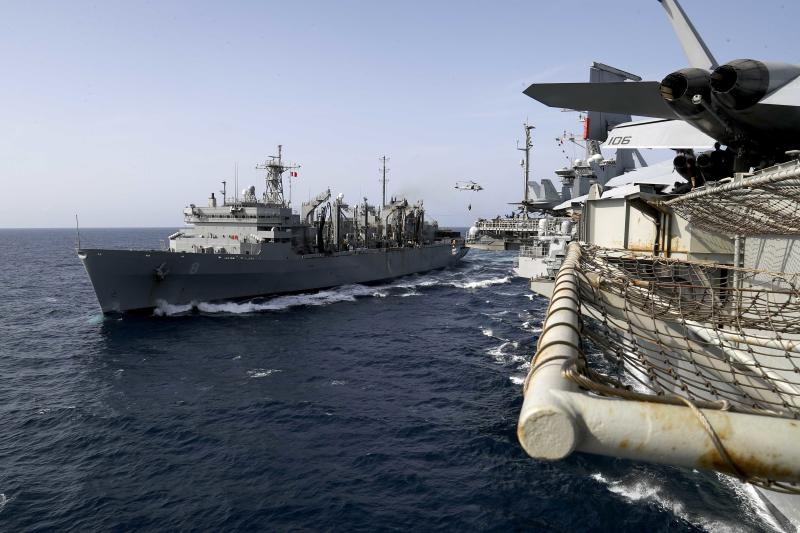 ADDS LOCATION - In this Sunday, May 19, 2019, photo released by the U.S. Navy, the fast combat support ship USNS Arctic transports cargo to the Nimitz-class aircraft carrier USS Abraham Lincoln during a replenishment-at-sea in the Arabian Sea. (Mass Communication Specialist 3rd Class Jeff Sherman/U.S. Navy via AP)
