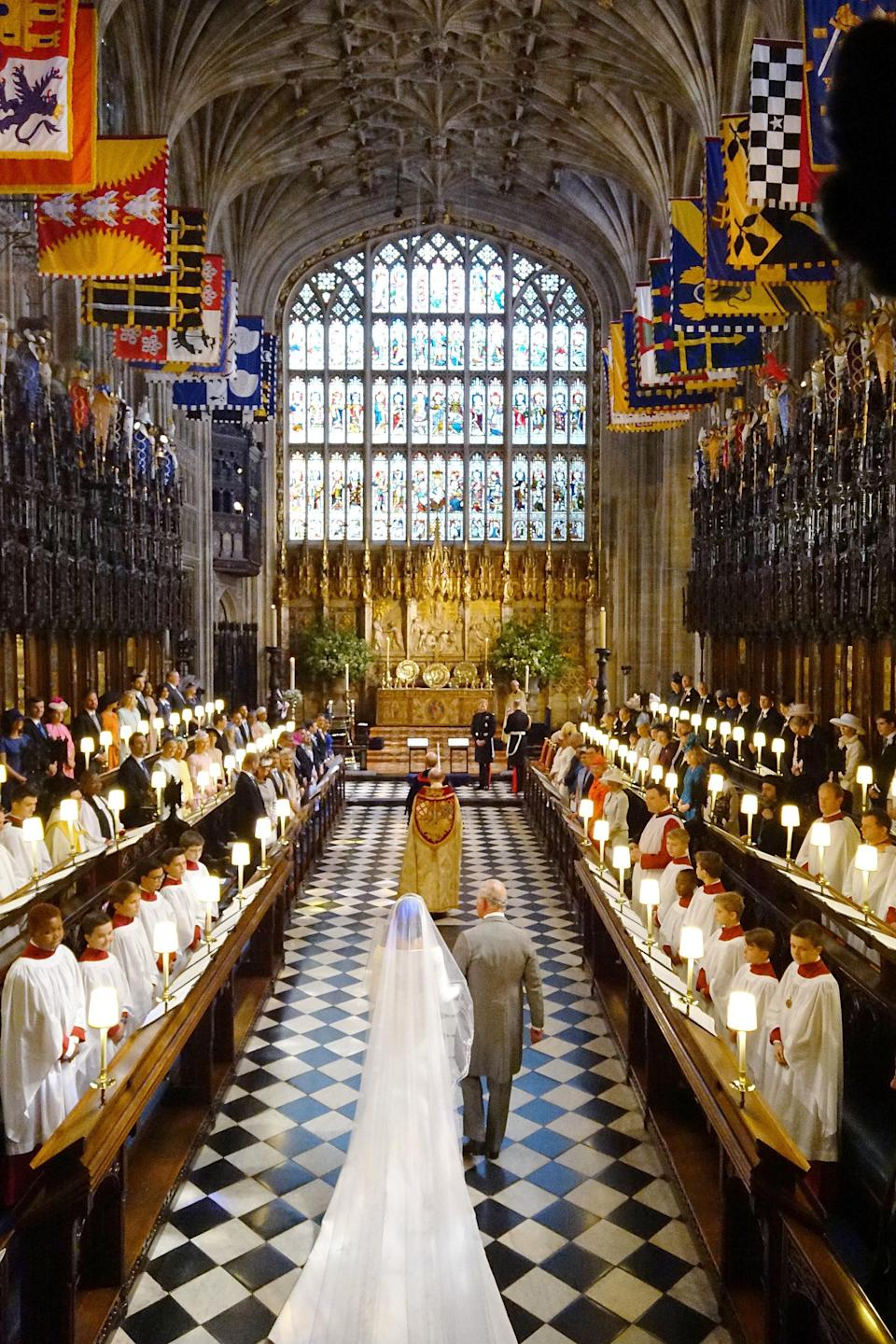 <p>After Meghan's father had to cancel his appearance at the wedding due to ill health, Prince Charles stepped in to walk Meghan halfway down the aisle. (Jonathan Brady/PA Wire) </p>