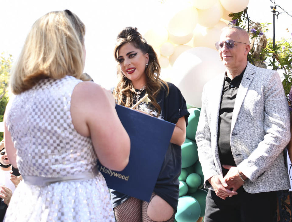 """WEST HOLLYWOOD, CALIFORNIA - MAY 23: (L-R)  Mayor Lindsey P. Horvath, Lady Gaga, and David Cooley onstage as Mayor Lindsey P. Horvath declares """"Born This Way Day"""" in the City of West Hollywood in celebration of the 10th anniversary of Lady Gaga's album """"Born This Way"""" at The Abbey on May 23, 2021 in West Hollywood, California. (Photo by Rodin Eckenroth/Getty Images)"""
