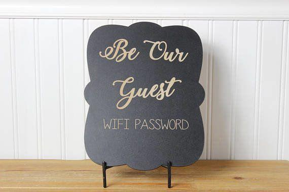 """Instead of having your guests read the house rules or wifi password off some crumpled piece of paper, get this <a href=""""https://www.etsy.com/listing/538774686/chalkboard-laser-engravedbe-our-guest?ga_order=most_relevant&ga_search_type=all&ga_view_type=gallery&ga_search_query=chalkboard%20wifi&ref=sc_gallery_1&plkey=c00bd2ebb4f3ff0f959d357e97bc5fffc030390d:538774686"""" target=""""_blank"""">inexpensive and customizable chalkboard from Etsy</a> to display all the answers to questions that guests may have."""