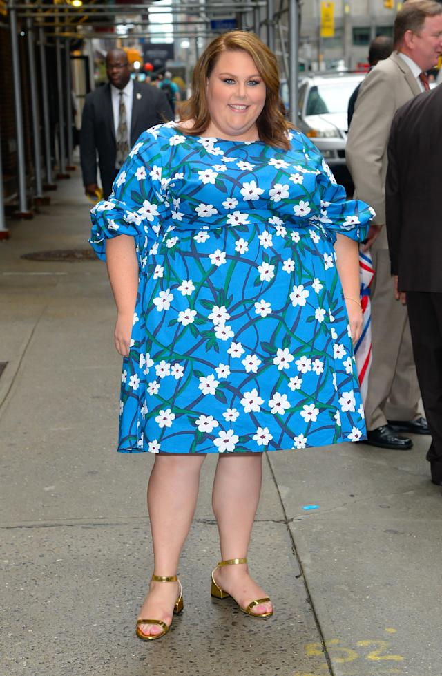 Chrissy Metz wears a floral-print dress from the Draper James and Eloquii collaboration on June 17 in New York City. (Photo: Raymond Hall/GC Images)