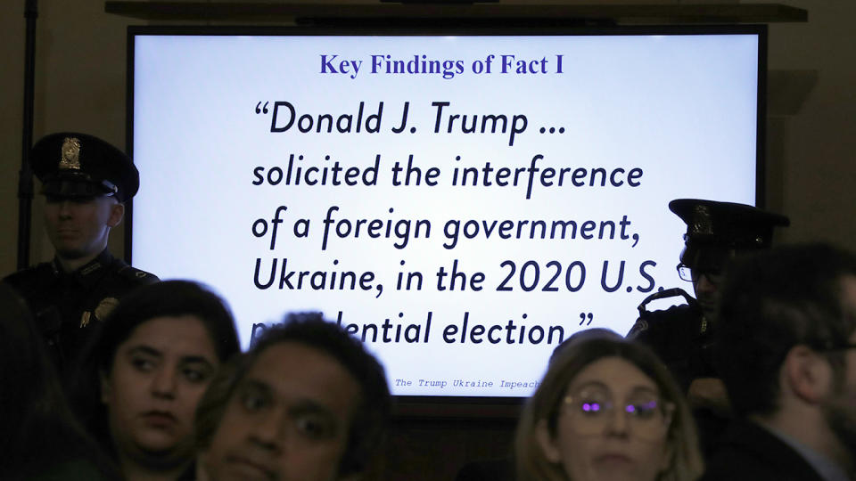 A television monitor displays a quote as constitutional law experts testify during a hearing before the House Judiciary Committee. (Photo: Jacquelyn Martin/AP)