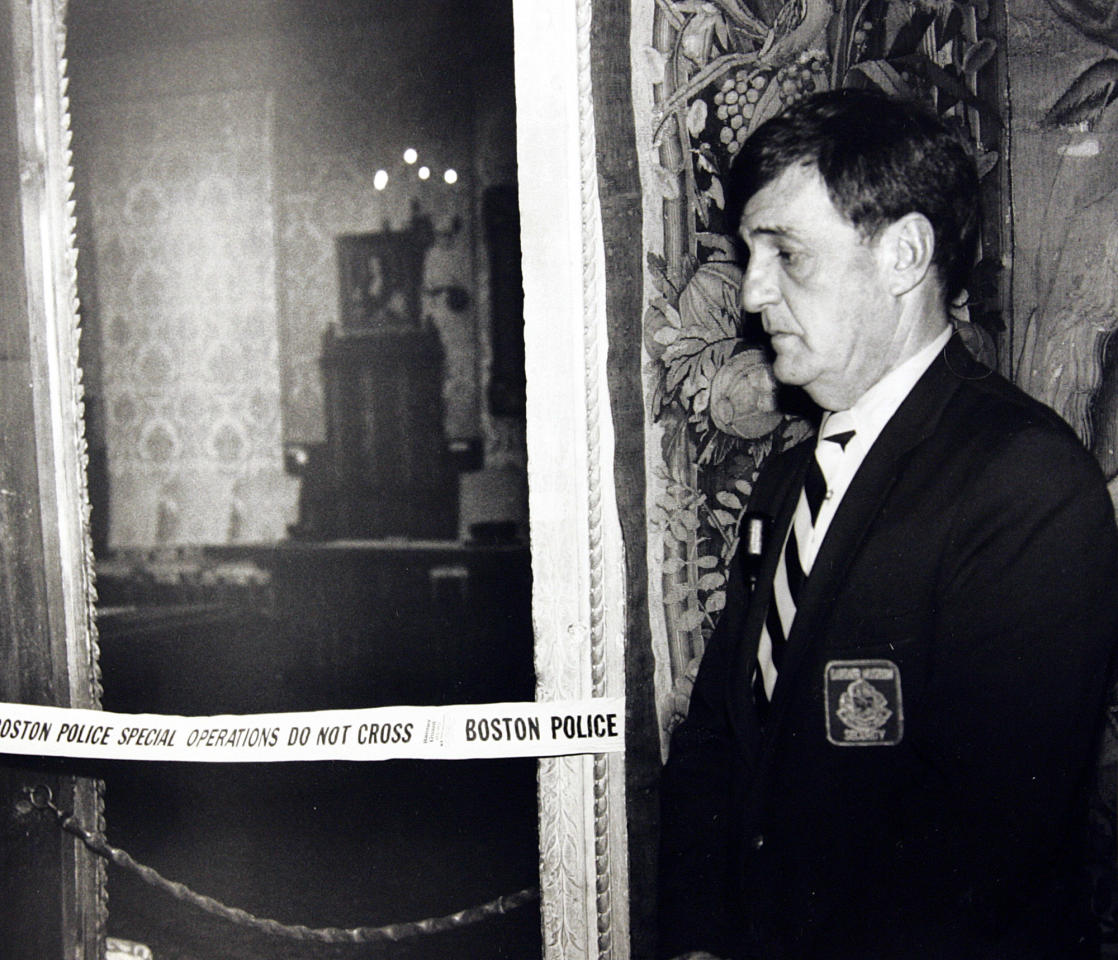 FILE - In this March 21, 1990 file photo, a security guard stands outside the Dutch Room of the Isabella Stewart Gardner Museum in Boston, where robbers stole more than a dozen works of art by Rembrandt, Vermeer, Degas, Manet and others, in an early morning robbery March 18, 1990. The FBI said Monday, March 18, 2013, it believes it knows the identities of the thieves who stole the art. Richard DesLauriers, the FBI's special agent in charge in Boston, says the thieves belong to a criminal organization based in New England the mid-Atlantic states. (AP Photo, File)