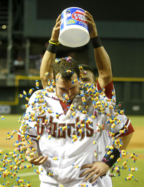 Arizona Diamondbacks first baseman Paul Goldschmidt (44), right, gets bubble gum poured on him after hitting a walk off homerun against the Baltimore Orioles during a baseball game on Tuesday, Aug. 13, 2013, in Phoenix. (AP Photo/Rick Scuteri)