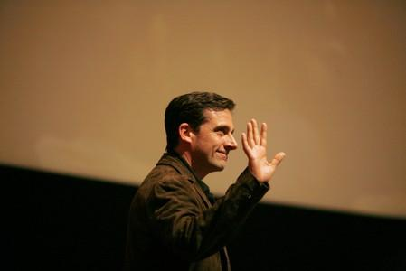 """FILE PHOTO: Steve Carell waves as he walks on stage for an """"Inside The Office"""" panel discussion at the Leonard H. Goldenson theatre in North Hollywood"""