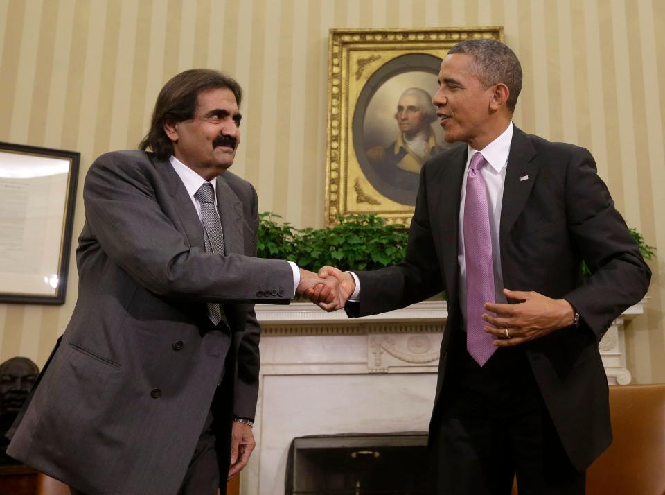 President Barack Obama shakes hands with Sheik Hamad bin Khalifa Al Thani of Qatar during their meeting in the Oval Office of the White House in Washington, Tuesday, April 23, 2013.