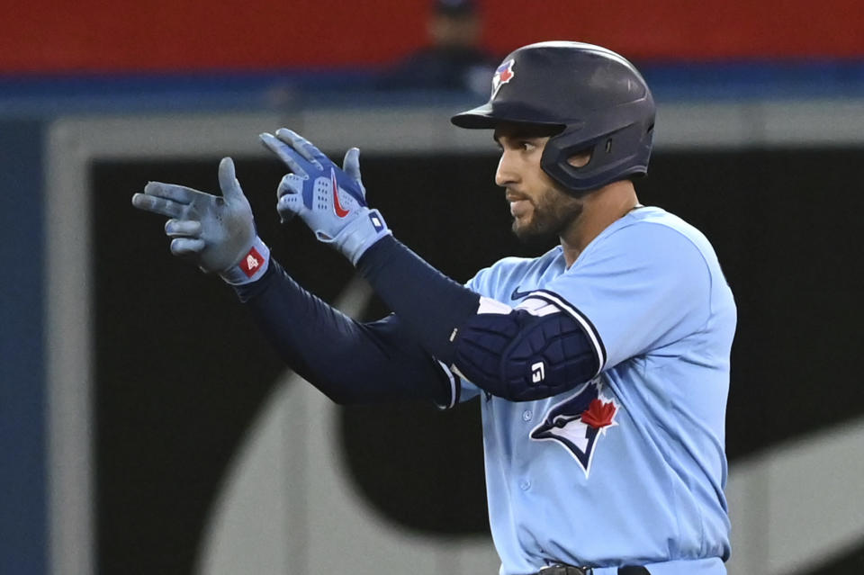 Toronto Blue Jays' George Springer motions to the dugout after hitting a double against the Oakland Athletics during the fifth inning of a baseball game Friday, Sept. 3, 2021, in Toronto. (Jon Blacker/The Canadian Press via AP