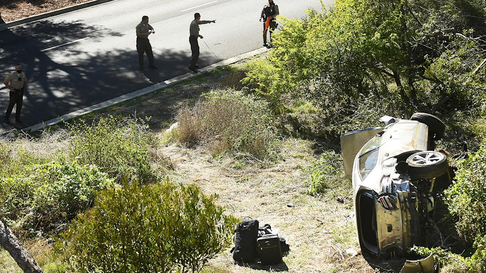 LA County Sheriff's officers, pictured here investigating an accident involving Tiger Woods.