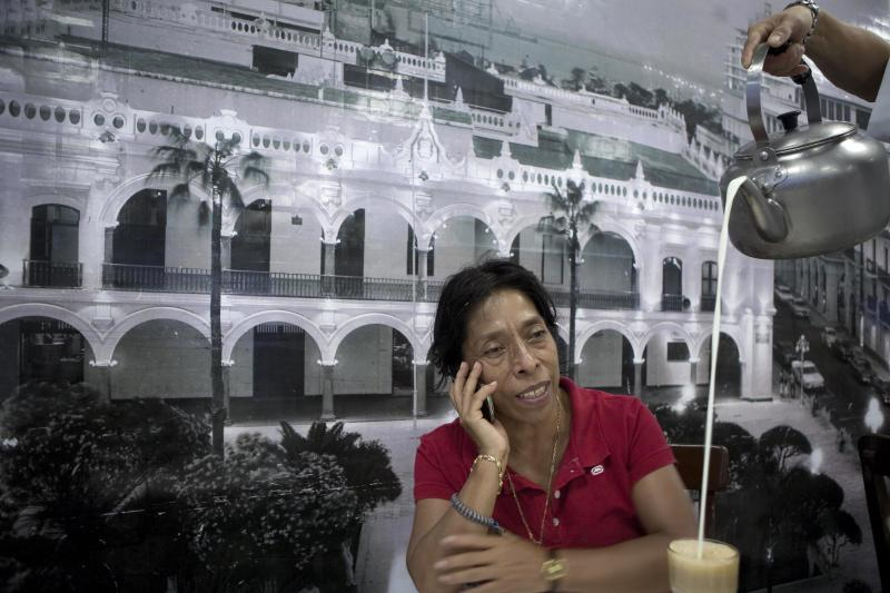 In this undated image released Sunday, April 29, 2012, by Newsmagazine Proceso, journalist Regina Martinez, talks on a cell phone at a restaurant in Veracruz, Mexico.  Martinez, a correspondent with Mexican newsmagazine Proceso was found dead inside her home in Veracruz state on Saturday and authorities believe the journalist who often wrote about drug trafficking was murdered. (AP Photo/Octavio Gomez, Newsmagazine Proceso)
