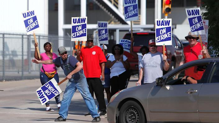 Mandatory Credit: Photo by LM Otero/AP/Shutterstock (10415460b)Gary Allison, left, waves while standing with other union members picketing outside the General Motors Plant in Arlington, Texas, .