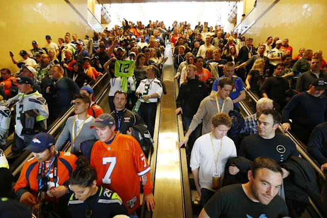Football fans make their way to trains on Sunday, Feb. 2, 2014, in Secaucus, N.J. The Seattle Seahawks are scheduled to play the Denver Broncos in NFL football's Super Bowl XLVIII game on Sunday evening at MetLife Stadium in East Rutherford, N.J. (AP Photo/Matt Rourke)