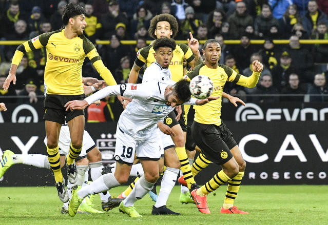 Hoffenheim's Ishak Belfodil heads his side's third goal during the German Bundesliga soccer match between Borussia Dortmund and TSG 1899 Hoffenheim in Dortmund, Germany, Saturday, Feb. 9, 2019. The match ended 3-3. (AP Photo/Martin Meissner)