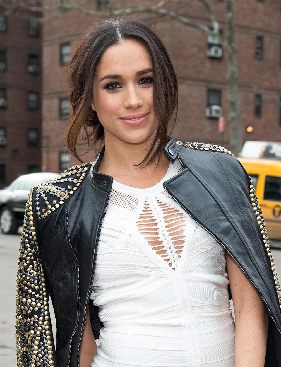 """<p>During Fall 2014 New York Fashion Week, the """"Suits"""" actress rocked a sultry, low ponytail along with an edgy studded moto jacket. (Photo: Gilbert Carrasquillo/GC Images) </p>"""