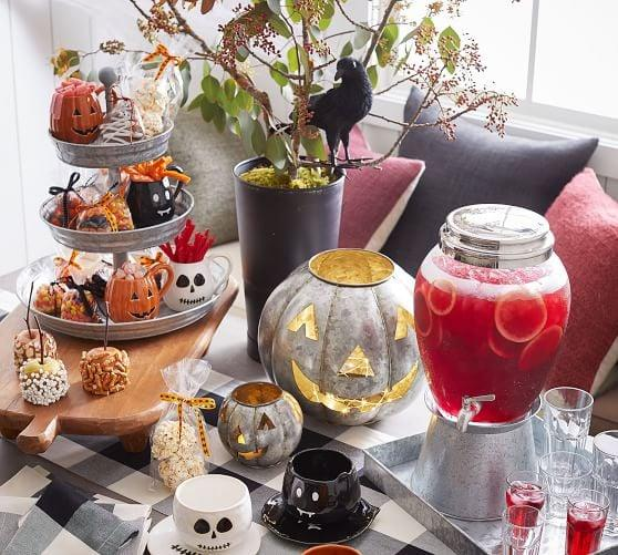 """<p>Give your home a warm and spooky glow with the <a href=""""https://www.popsugar.com/buy/Galvanized-Metal-Jack-OLanterns-480548?p_name=Galvanized%20Metal%20Jack%20O%27Lanterns&retailer=potterybarn.com&pid=480548&price=24&evar1=casa%3Aus&evar9=46504162&evar98=https%3A%2F%2Fwww.popsugar.com%2Fphoto-gallery%2F46504162%2Fimage%2F46504165%2FGalvanized-Metal-Jack-OLanterns&list1=shopping%2Challoween%2Cpottery%20barn%2Challoween%20decor%2Chome%20shopping&prop13=api&pdata=1"""" rel=""""nofollow"""" data-shoppable-link=""""1"""" target=""""_blank"""" class=""""ga-track"""" data-ga-category=""""Related"""" data-ga-label=""""https://www.potterybarn.com/products/galvanized-metal-lantern-candle-holder-pumpkin/?pkey=s%7Challoween%20decor%7C134"""" data-ga-action=""""In-Line Links"""">Galvanized Metal Jack O'Lanterns</a> ($24-$47, originally $30-$59).</p>"""