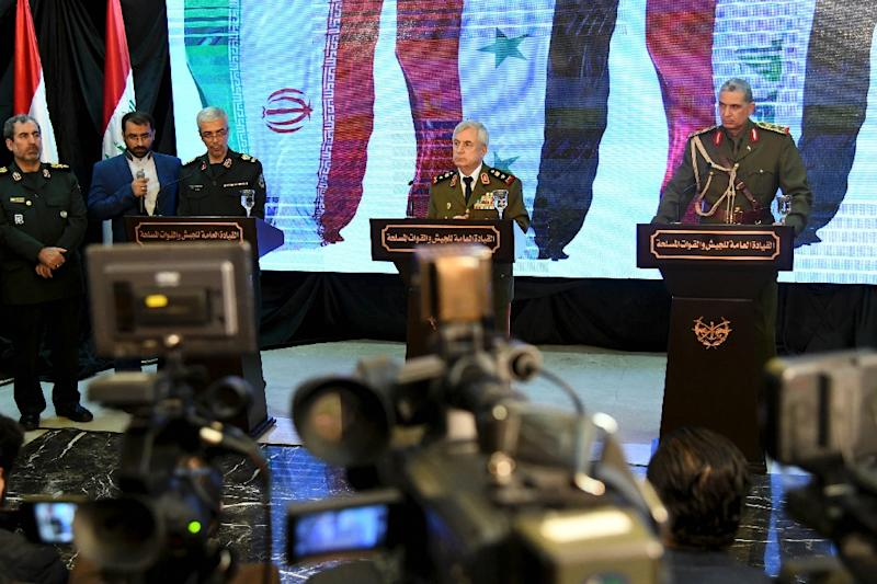 Syrian Defence Minister Ali Abdullah Ayoub (C) at a joint press conference in Damascus on March 18, 2019 with Iraq's Chief of Staff Othman al-Ghanimi (R) and Iran's Chief of Staff Mohammad Hossein Bagheri (AFP Photo/-)