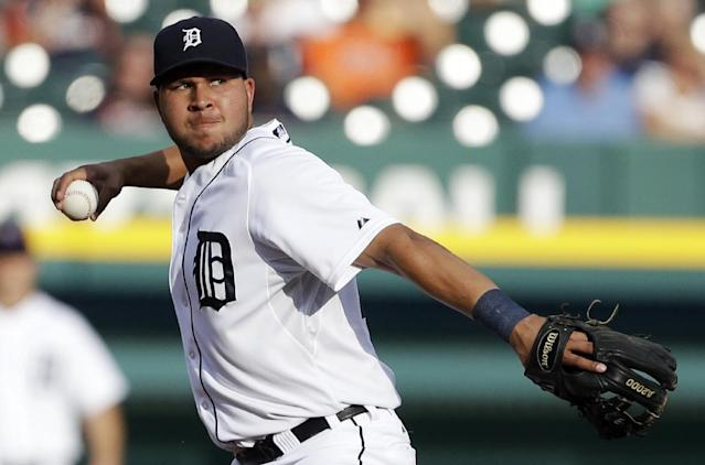 FILE - In this July 10, 2013, file photo, Detroit Tigers shortstop Jhonny Peralta makes a throw to first during a baseball game against the Chicago White Sox in Detroit. A person familiar with the negotiations tells The Associated Press that free agent shortstop Peralta and the St. Louis Cardinals have agreed on a four-year contract. (AP Photo/Carlos Osorio, File)