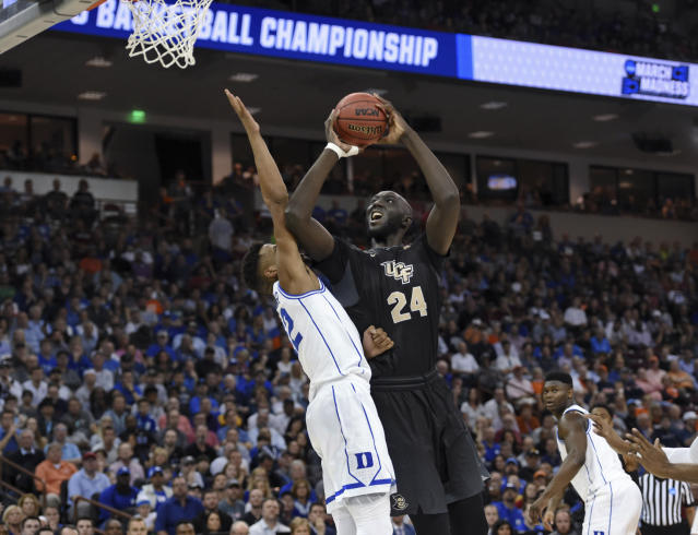 Central Florida's Tacko Fall (24) drives the basket against Duke's Javin DeLaurier during the first half of a first-round game in the NCAA men's college basketball tournament in Columbia, S.C., Sunday, March 24, 2019. (AP Photo/Richard Shiro)