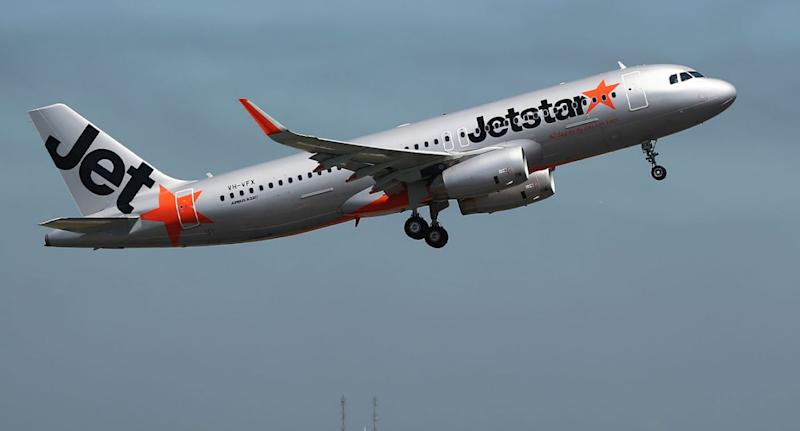 Picture of a Jetstar plane in the air. Jetstar was forced to cancel multiple flights due to strikes across the country