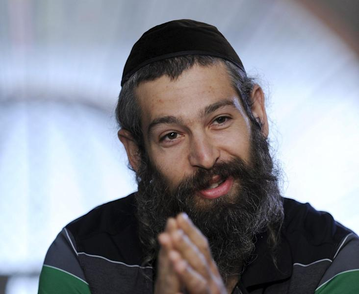 "FILE - This Sept. 3, 2010 file photo shows Hassidic raggae musician Matthew Paul Miller, aka Matisyahu, during an interview in Budapest, Hungary. The 33-year-old Matisyahu is far from the one who lived for years in a modest apartment in Crown Heights, the Orthodox Jewish neighborhood in Brooklyn. He's moved his wife and three sons to Los Angeles, favors pastels over dark suits, ditched the yarmulke, changed his management team, and is self-releasing his music. This month, he releases his fourth studio CD, ""Spark Seeker,"" a fresh sound produced by Kool Kojak with reggae, hip-hop and electronica layered over Middle Eastern instruments and rhythms. (AP Photo/MTI, Zsolt Demecs, file)"