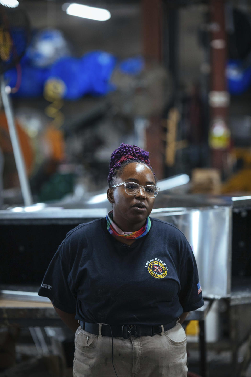 Sheet metal worker Carey Mercer at Contractors Sheet Metal on Tuesday, Aug. 3, 2021, in New York. The construction industry is fighting to recruit more women into a sector that faces chronic labor shortages. Women make up only 4% of skilled construction laborers in the U.S. and often face discrimination on jobs sites. (AP Photo/Kevin Hagen)