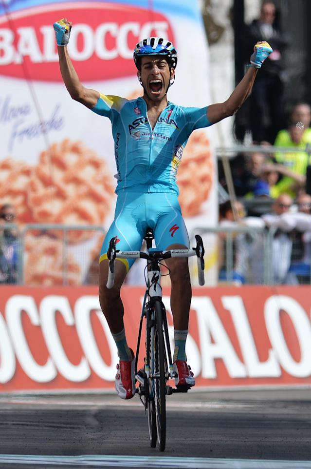 Italy's Fabio Aru celebrates as he crosses the finish line to win the 15th stage of the Giro D'Italia cycling race from Valdengo to Plan di Montecampione, Italy, Sunday, May 25, 2014. (AP Photo/Gian Mattia D'Alberto)
